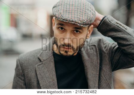 Man Gangster In A Cap And Beard Close-up Young Handsome Man In Coat