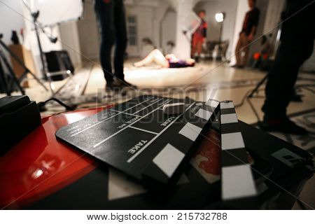 Film Movie Background, Clapperboard And Video Light In A Studio