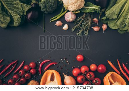 top view of colored ripe vegetables on gray tabletop