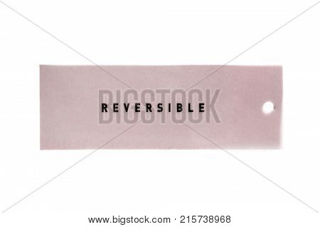 Pink label lettered reversible isolated over white