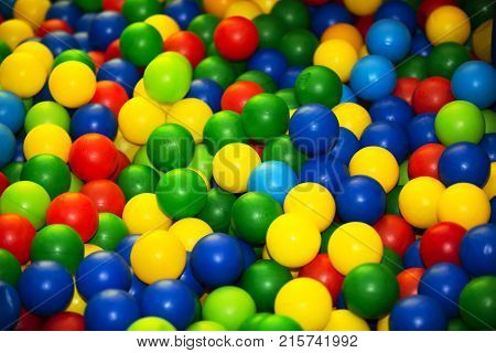 Plastic multi-colored balls. Many colored plastic multi-colored balls