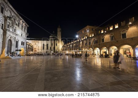 ASCOLI PICENO, ITALY - JULY 10, 2017: Ascoli Piceno (Marches Italy): the famous Piazza del Popolo the medieval main square of the city at evening with people