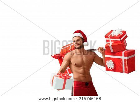 Fitness holidays. Ripped fitness man wearing Santa Claus hat giving away a present posing with a barbell on his shoulder isolated on white, 2018, 2019.