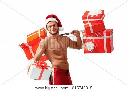 Fitness advices from Santa. Portrait of a shirtless ripped Santa Claus offering a big gift box looking away smiling happily, 2018, 2019.
