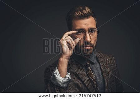 Man Adjusting Glasses