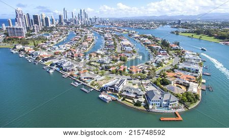 Aerial view of Macintosh Island waterfront properties, facing south with Surfers Paradise in the horizon