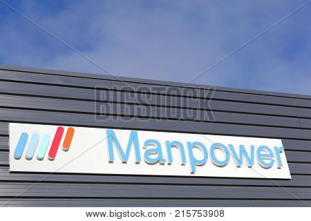 Dax, France - June 5, 2017:  Manpower logo on a wall. ManpowerGroup is the third-largest staffing firm in the world behind Swiss firm Adecco and Dutch firm Randstad