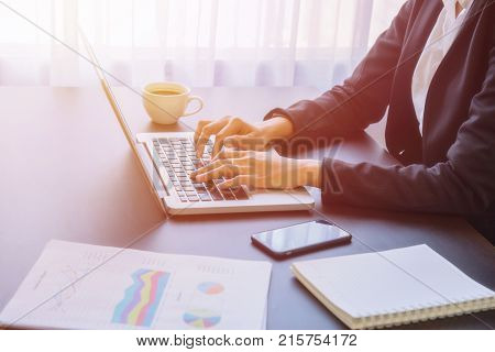 A young business woman using laptop computer on the table Looking for direction and inspiration.