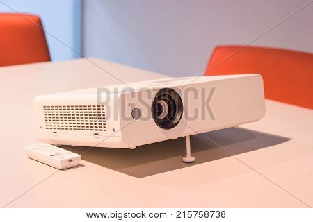 projector for presentation in a meeting room, (Light in a light yellow tone room.)