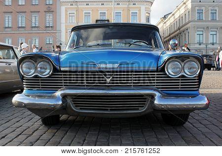 HELSINKI FINLAND - AUGUST 7 2017: Old American blue car at Helsinki Cruising Night (Retro Cars Show) on Kauppatori square Helsinki August 4 2017