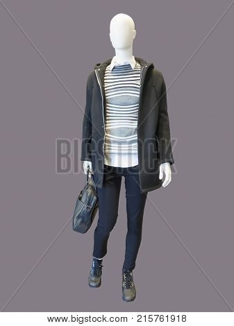Full-length male mannequin dressed in warm coat with hood isolated. No brand names or copyright objects.