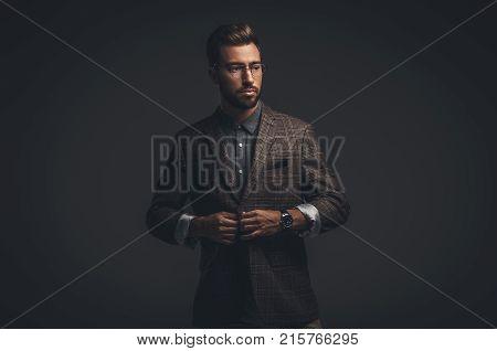 Sophisticated Man Adjusting Jacket
