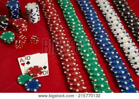 Poker cards and gambling chips on red background. Top view. Copy space. Still life. Flat lay. Cards - Ace and Ten poster
