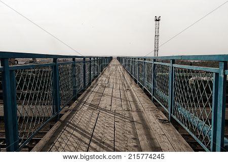 Pedestrian bridge over the railway. Pedestrian bridge. Bridge. Wooden bridge.