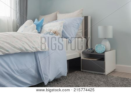 Set Of Blue And White Pillows On Bed