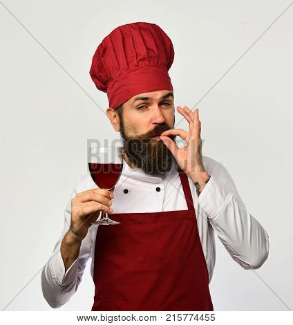 Man With Beard Holds Glass Of Wine On White Background