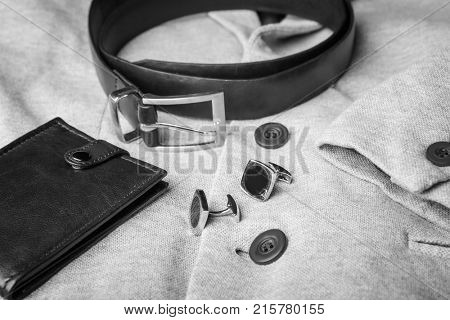 Elegant wallet, belt and cuff links on male jacket, closeup