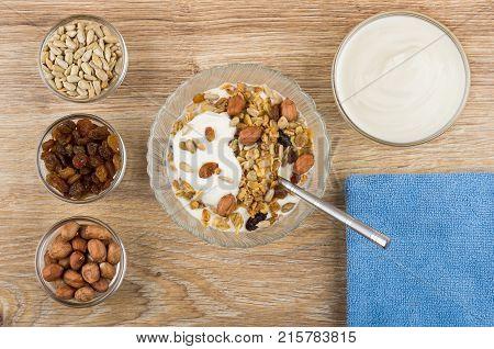 Muesli With Yogurt, Sour Cream, Bowls With Raisins, Peanuts, Seeds