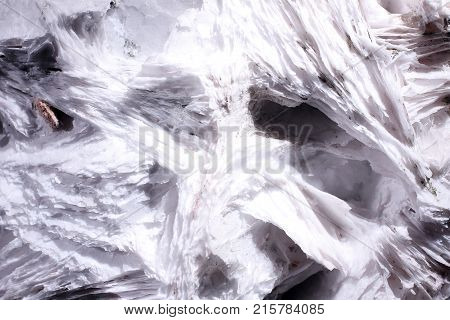 White looking leafy calcite abstract look. Natural phenomenon. Shiny and milky.