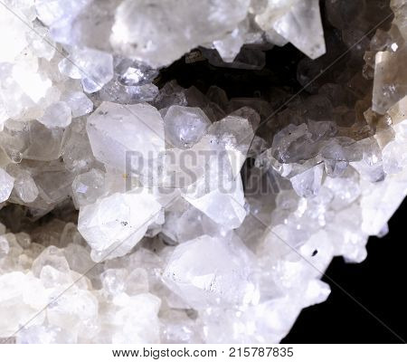 Closeup photograph of calcite with pyrite. Translucent, glittery, with small part of black background. Natural phenomenon. Abstract look.