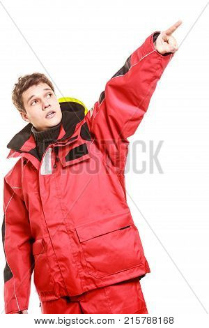 Adventurous man making gesture. Young male in weatherproof clothing. Adventure communication outdoors danger concept.