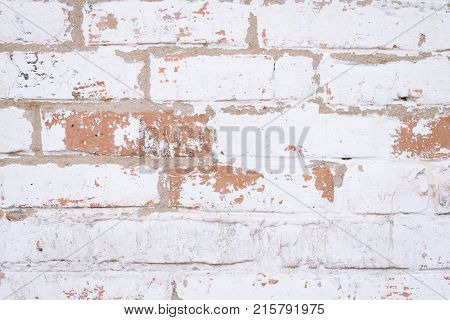 Old Red Brick Wall With Shabby Damaged White Plaster.