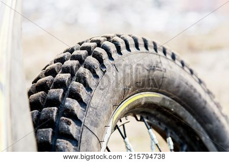 Protector of a motorcycle wheel for off-road ride enduro and trial. A close-up of rubber for extreme driving motorcycles. The concept of motor sport trial