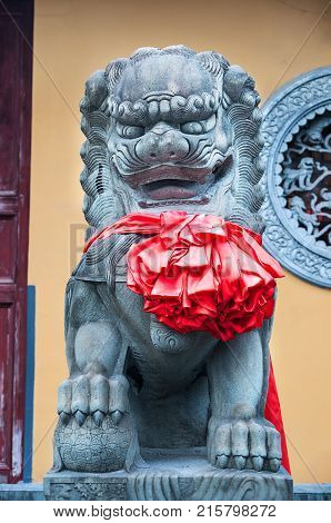 Chinese Imperial Lion Statue, Chinese guardian lions with red bow on chest.