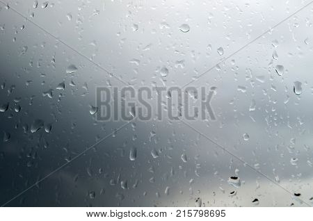 Water rain drops background. Closeup of water rain drops on the window. Rain drops on the glass window surface, natural background of water rain drops.