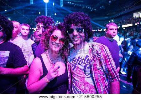 CLUJ NAPOCA, ROMANIA - NOVEMBER 19, 2017: Crowd of cheerful people dancing and partying during the We Love Retro Disco Party