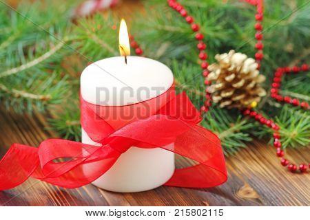 Burning Candle On The Christmas Tree Background
