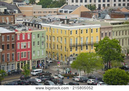 NEW ORLEANS - MAY. 29, 2017: Historic Buildings on N Peters Street at Bienville Street in French Quarter in New Orleans, Louisiana, USA.