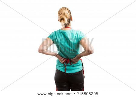 Tired Housemaid Or Housekeeper Suffering Lower Back Pain