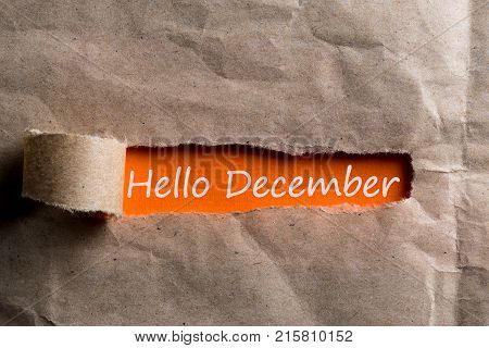 Hello december inscription hiding in a tattered envelope. December 1, the beginning of the Christmas and New Year holidays and sales.