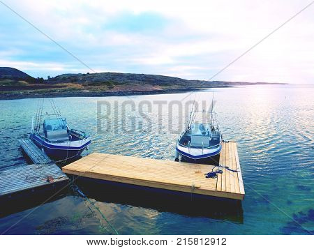 Fishing Boat In Bay Port, Sunset Calm Water. A Motorboat For Sport Fishing
