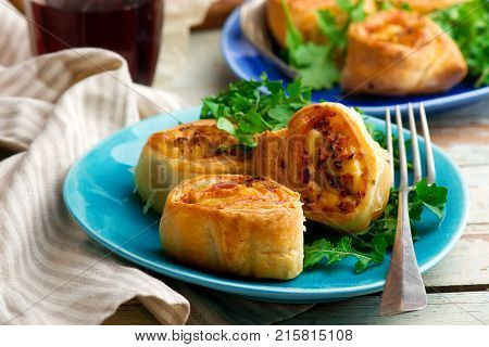 chicken cordon bleu crescent rolls. style rustic. selective focus