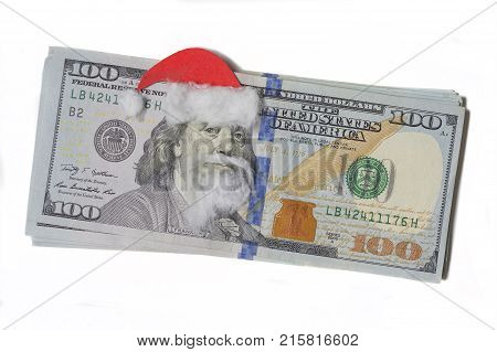 Benjamin Franklin in a Santa Claus hat on a banknote isolated a white background