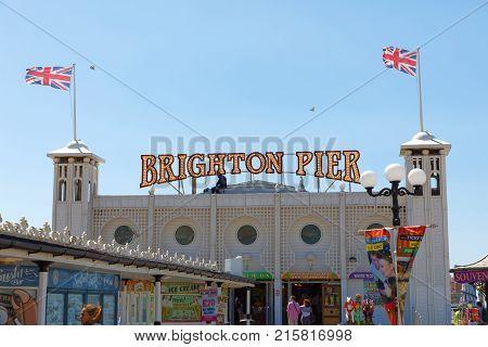 BRIGHTON GREAT BRITAIN - JUN 15 2017: Entrance of the Brighton pier. June 15 2017 in Brighton Great Britain