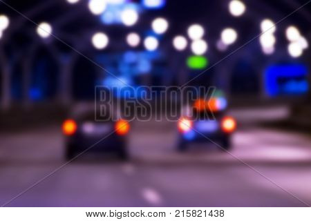 Night city view in blur. City street blurry photo. Street life bokeh image. Street view with pedestrians and cars defocused image. Road in big city bokeh image. Night city lifestyle blurry background