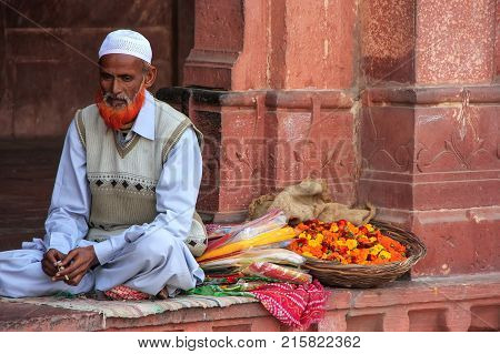 Fatehpur Sikri, India-january 30: Unidentified Man Sells Flowers In The Courtyard Of Jama Masjid On