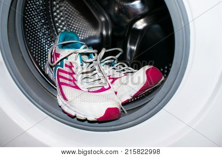 White and pink sneakers wash in the washer (automatic washing machine). How to clean sneakers