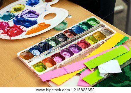 A set for creativity: different colors and brushes, watercolor, gouache, colored paper. Children's creative. Paint set