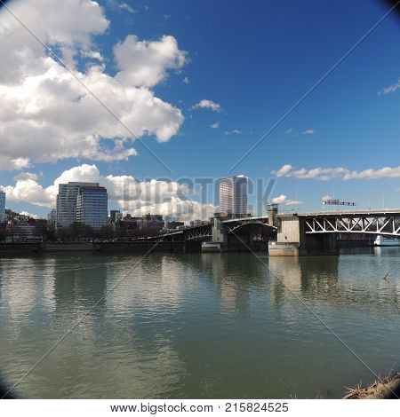 Downtown Portland Oregon with draw bridge across the Willamette River on a sunny day