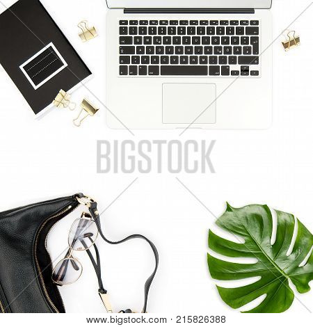 Fashion flat lay for social media. Office desk. Laptop green leaf notebook on white background.