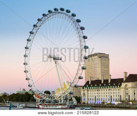 LONDON, UK - OCTOBER 1, 2015: London Eye or Millenium Wheel on South Bank of River Thames in London England