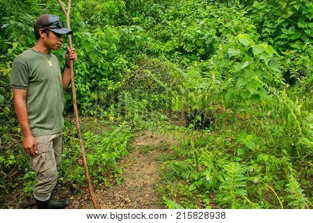 Rinca, Indonesia - March 15: Unidentified Man Shows Hole Made By Dragon On Rinca Island On March 15,