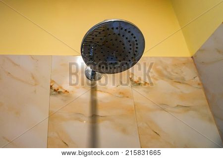 Hard water calcium deposit and corrosion on chrome shower tap