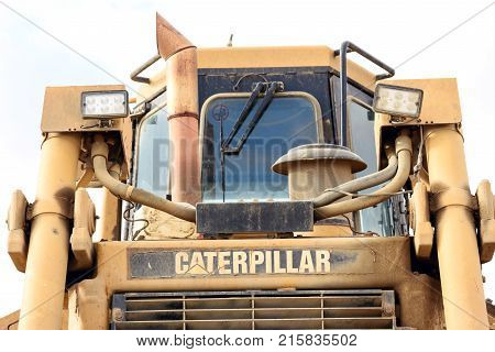 ESSEX, ENGLAND 10TH NOVEMBER 2017 - Parked yellow Caterpillar bulldozer dozer at a local sand gravel pit in Silver End Essex England