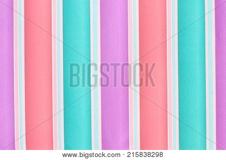 Multicolor stripes background. Multicolored striped gift paper wallpaper. Colorful striped abstract background.