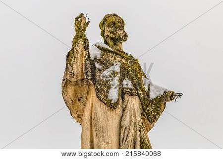 VARAZDIN, CROATIA - FEBRUARY 07, 2015 Statue Of Saint Ivan Nepomuk with damaged palms in the Old Town in winter time.